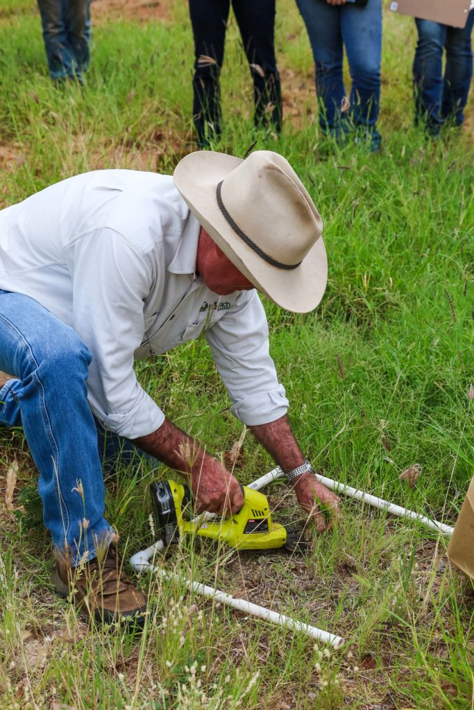 Col Paton, EcoRich grazing cuts a quadrat of pasture from which total standing dry matter per hectare can be calculated.