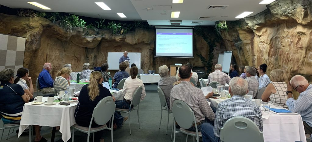 Attendees in an interesting looking conference room look towards the presenter at the Phosphorus Management workshop.