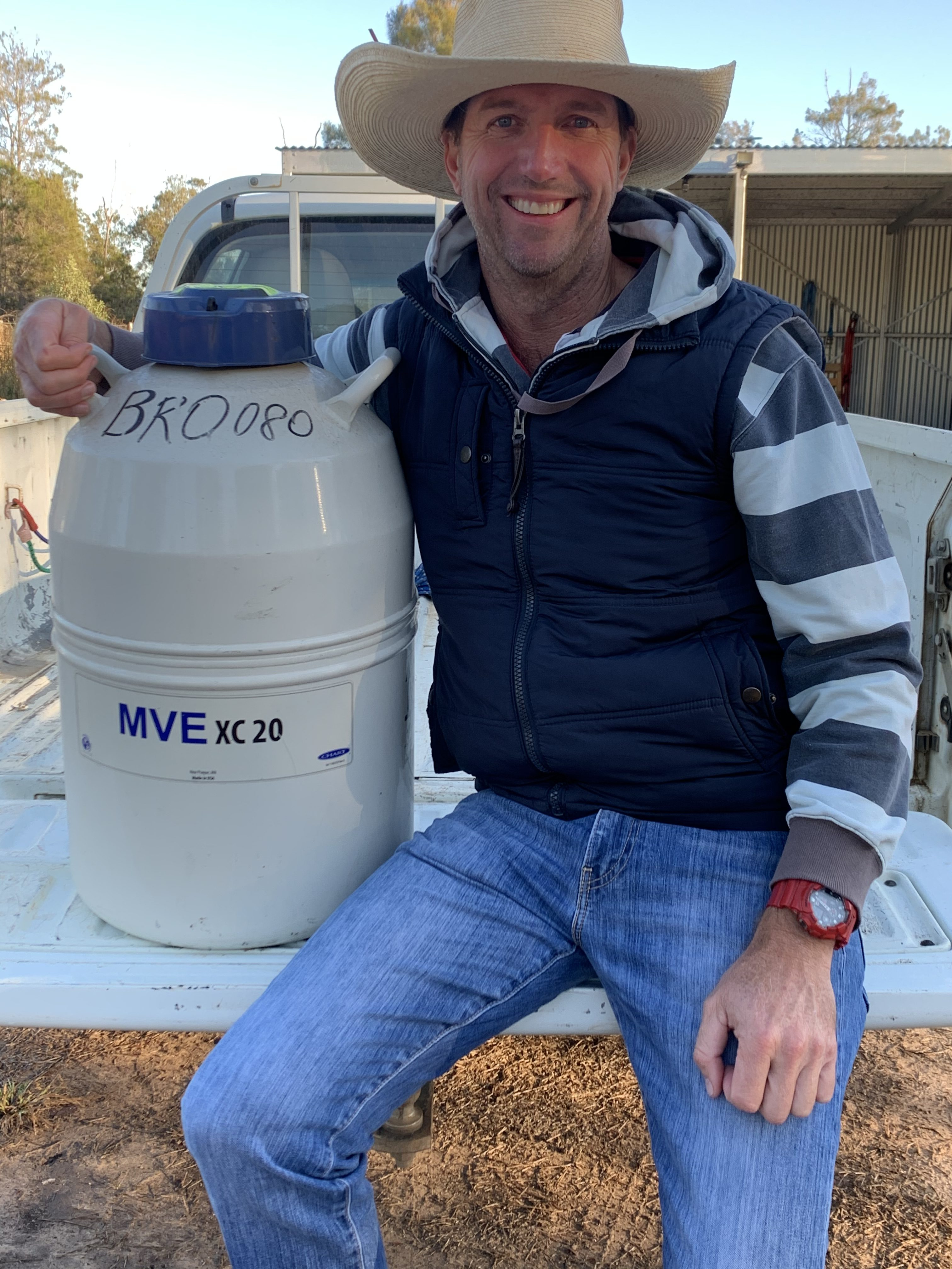 Matt Brown with a semen storage tank on the back of a vehicle.