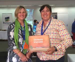 Claire Kapernick (R) receiving her lucky door prize, with Jo Gangemi, DAF Biloela (L).